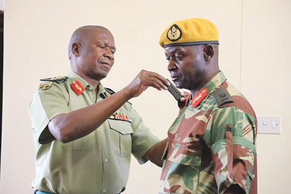 Zimbabwe Defence Forces commander General Philip Valerio Sibanda (left) confers the rank to Presidential Guard commander Major-General Anselem Nhamo Sanyatwe recently