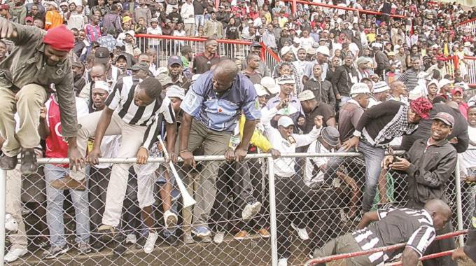 Highlanders fans jump over a fence in this file picture.