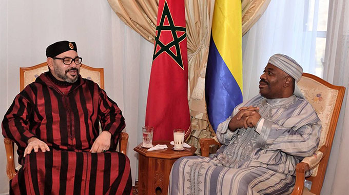 Morocco's King Mohamed VI (L) visiting Gabon's President Ali Bongo at the military hospital in the capital Rabat. - AFP