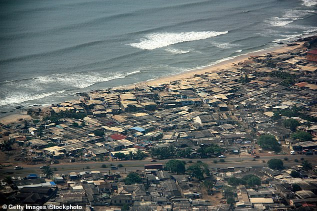 Hundreds of corrugated iron roofed huts can be seen lining the shore in the heart of Accra, Ghana; the schoolgirls and their teacher were flown home from the city after the attack