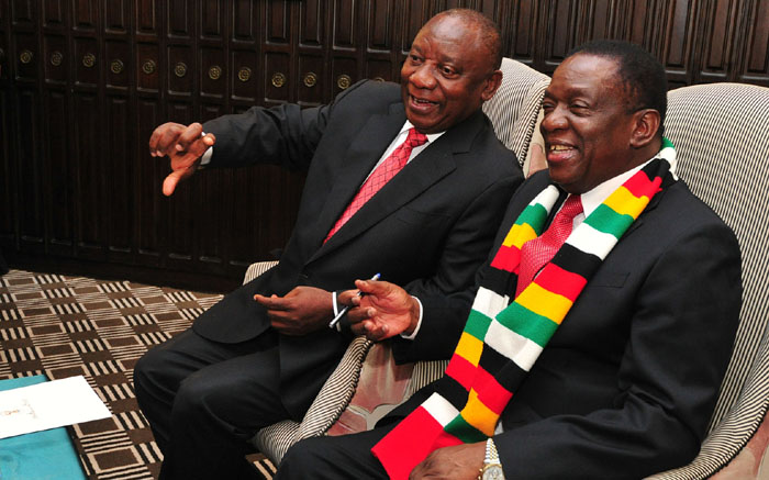 Zimbabwe's President Emmerson Mnangagwa and his South African counterpart Cyril Ramaphosa arrive for bilateral talks in Harare.
