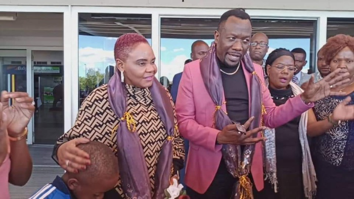 Ivy Kombo and Admire Kasi on arrival back home in Zimbabwe from the UK