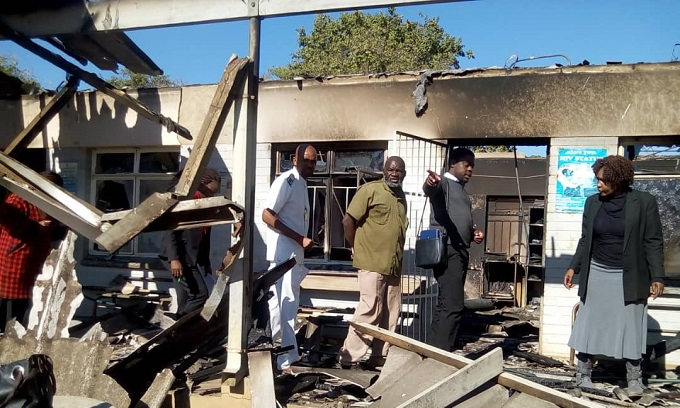 Members of the public led by Lupane District Administrator Ms Ennety Sithole tours fire gutted St Lukes Hospital which was gutted by fire