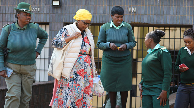Former Environment, Tourism and Hospitality Industry Minister Priscah Mupfumira looks colourful as she makes her way into the Harare Magistrates' Courts yesterday. — (Picture by Lee Maidza)