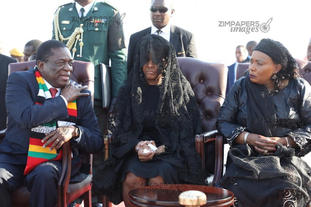 Mugabe's wife Grace, dressed in black and wearing a veil, was next to Mnangagwa at the airport. As she left the tarmac in a vehicle behind the hearse, Grace could be seen wiping away tears and being consoled by one of her sisters.