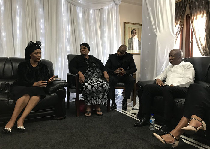 Julius Malema sits down with Grace Mugabe and family – Photo: EFF / Twitter