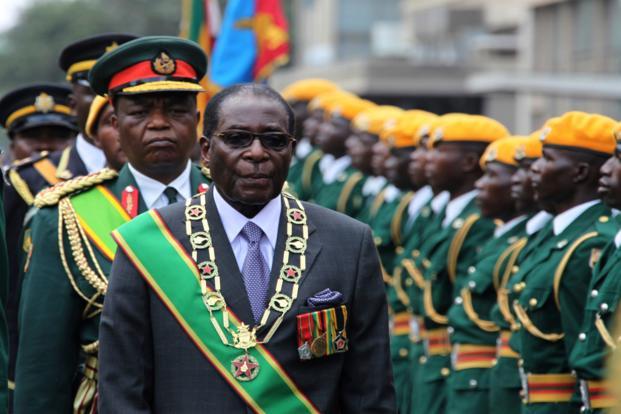 The late former President Robert Mugabe inspecting a guard of honour (Picture by AP/Tsvangirayi Mukwazhi)