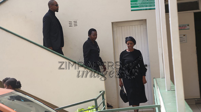 Grace Mugabe, Simba Chikore and unidentified woman leaving Master of High Court.- (Picture by Aaron Nyamayaro)