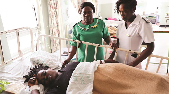 A Mutare Provincial Hospital sister-in-charge (in green) and a nurse attend to a victim of the accident yesterday. — Pictures :Tinai Nyadzayo