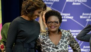 First lady Michelle Obama hugs Beatrice Mtetwa, of Zimbabwe, a prominent human rights lawyer and a 2014 International Women of Courage award winner, during a ceremony at the State Department in Washington, Tuesday, March 4, 2014. (AP Photo/Jacquelyn Martin)
